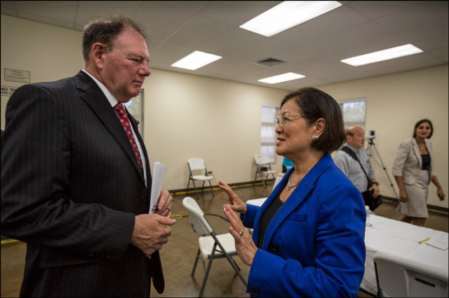 Sen. Mazie Hirono speaks with Wayne Pfeffer, Director of the VA Pacific Islands Health Care System after Senate Veteran's Affairs Committee Field Hearing at the Oahu Veterans Center on August 19, 2014.