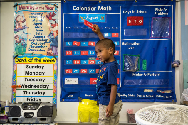 Kindergarten student going over days of the week at Ala Wai Elementary School on August 21, 2014