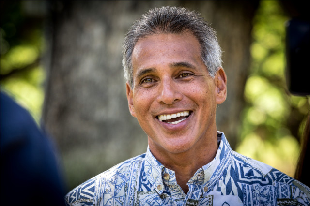 Former Lt. Gov. Duke Aiona talks to TV crew after voting early at Honolulu Hale on August 6, 2014.