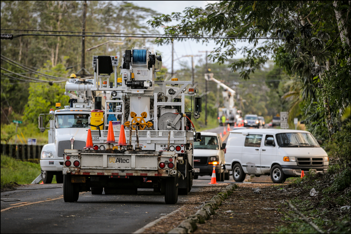 HELCO crews work to fix power lines and restore power. It was a common sight through the area, and such trucks often blocked the main arteries through various subdivisions as staff worked to restore power to tens of thousands of people with electricity.