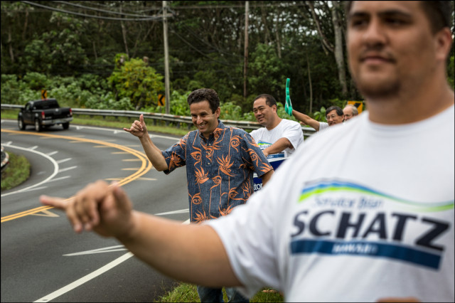Sen. Brian Schatz and supporters wave to motorists near Keonepoko Elementary School on special election day August 15, 2014