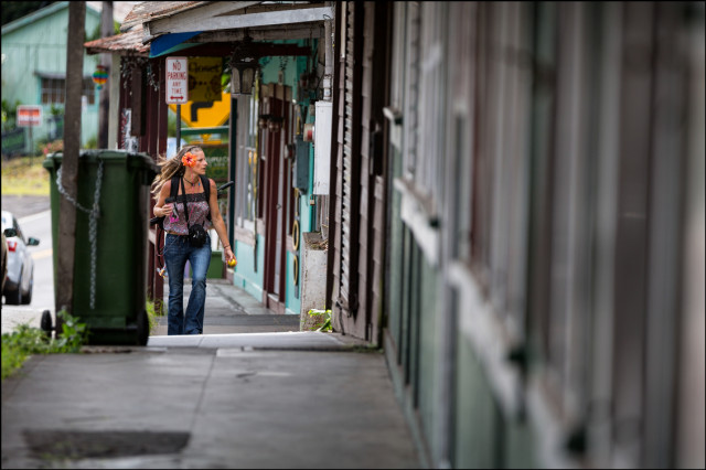 Woman from another era walks on main road in Pahoa Village on August 15, 2014