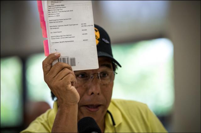 Veteran Cummins Kameeiamoku Mahoe III holds up outdated VA handbook as he testifies at the Senate Veteran's Affairs Committee Field Hearing at the Oahu Veterans Center on August 19, 2014.