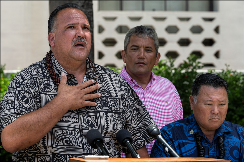Kauai Mayor Bernard Carvalho, speaks at news conference along with Hawaii County Mayor Billy Kenoi and Maui Mayor Alan Arakawa in front of Honolulu Hale to give their reaction to a federal court decision that struck down a Kauai County ordinance that requires biotechnology companies to disclose their cultivation of genetically modified crops and use of restricted pesticides. August 25, 2014