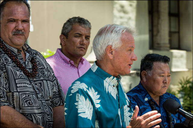 Honolulu Mayor Kirk Caldwell, along with Kauai Mayor Barnard Carvalho, Hawaii County Mayor Billy Kenoi and Maui Mayor Alan Arakawa, speaks at news conference in front of Honolulu Hale to give their reaction to a federal court decision that struck down a Kauai County ordinance that requires biotechnology companies to disclose their cultivation of genetically modified crops and use of restricted pesticides. August 25, 2014