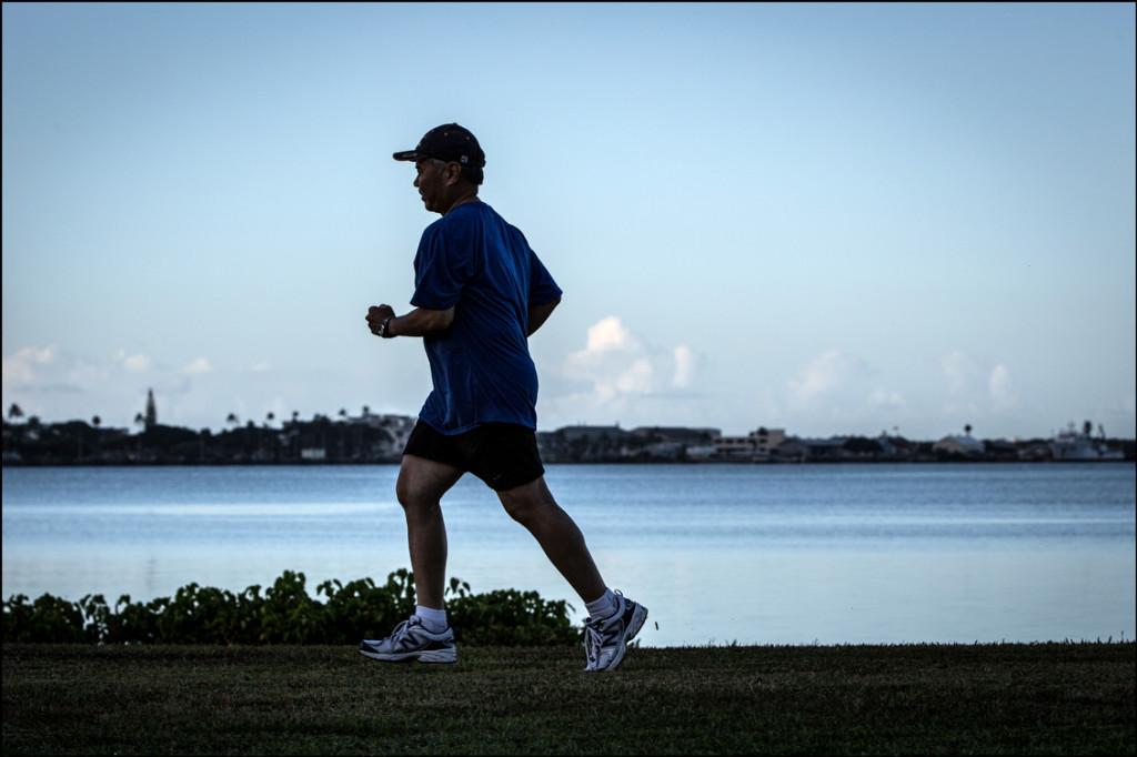 Sen. David Ige jogs near Pearl Harbor on August 28, 2014.
