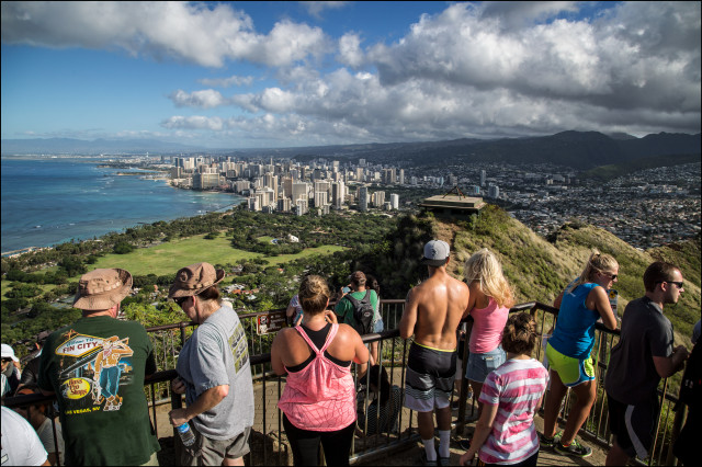 Hikers at the top of the Diamond Head looking out over Waikiki and Honolulu on July 24, 2014.