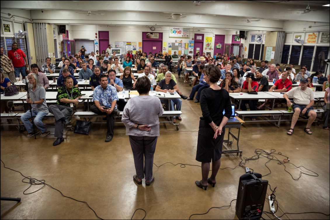 Ember Shinn, Managing Director for the City & County of Honolulu on left and Pam Witty-Oakland Director of Department of Community Services speaks to crowd during a public meeting on the proposed Sand Island Housing First Transition Center held in the Pu'uhale Elementary School cafeteria on September 10, 2014