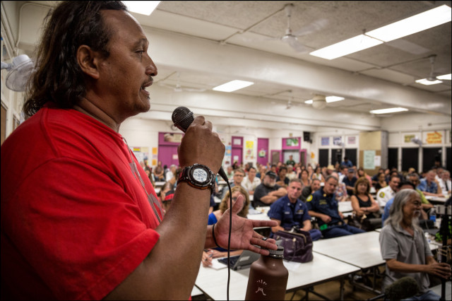 Kiko, a member of Sand Island Crew and Regulars speaks to crowd during a public meeting on the proposed Sand Island Housing First Transition Center held in the Pu'uhale Elementary School cafeteria on September 10, 2014