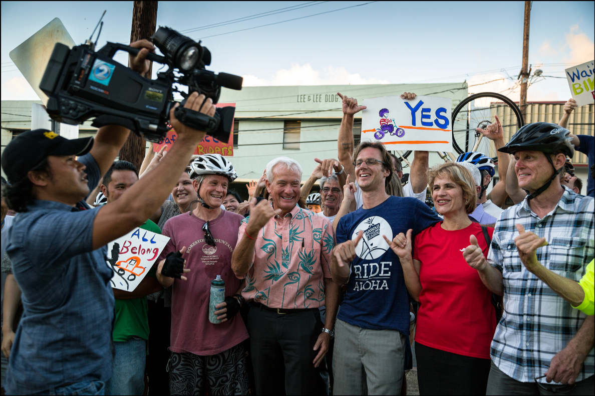 Mayor Caldwell and the crowd of cyclists took part in a shaka moment before the KHON camera for the nightly news.