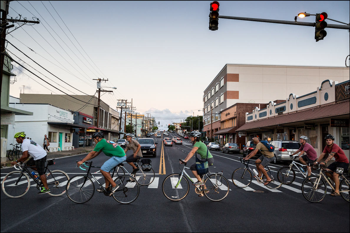 Bicycling League members accidentally imitate The Beatles, but on bikes, in Kaimuki.