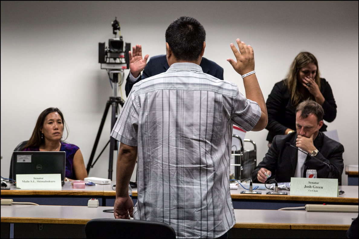 Psychiatric technician Ryan Oyama, shown getting sworn in by Sen. Hee, testified that going public about problems at the hospital earned him threats of firing by his supervisor.