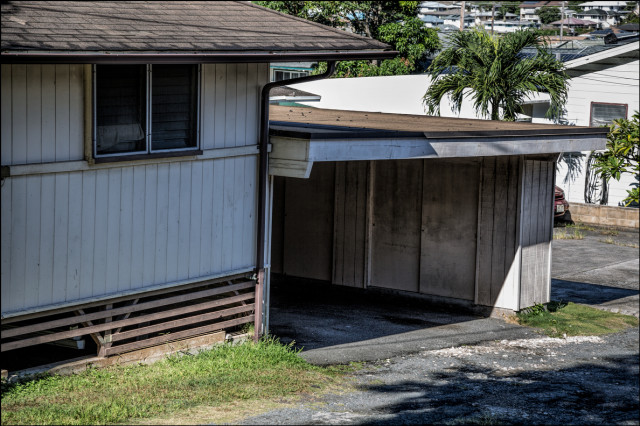 An empty garage at Speaker Emeritus Calvin Say's Palolo house on 10th Ave. on September 17, 2014