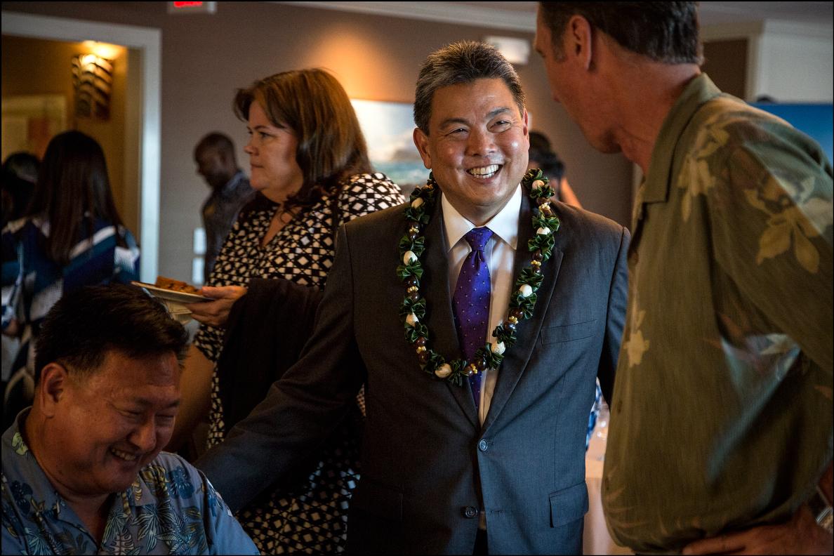 Democrat Mark Takai chats up spectators before the Chamber's CD1 debate.