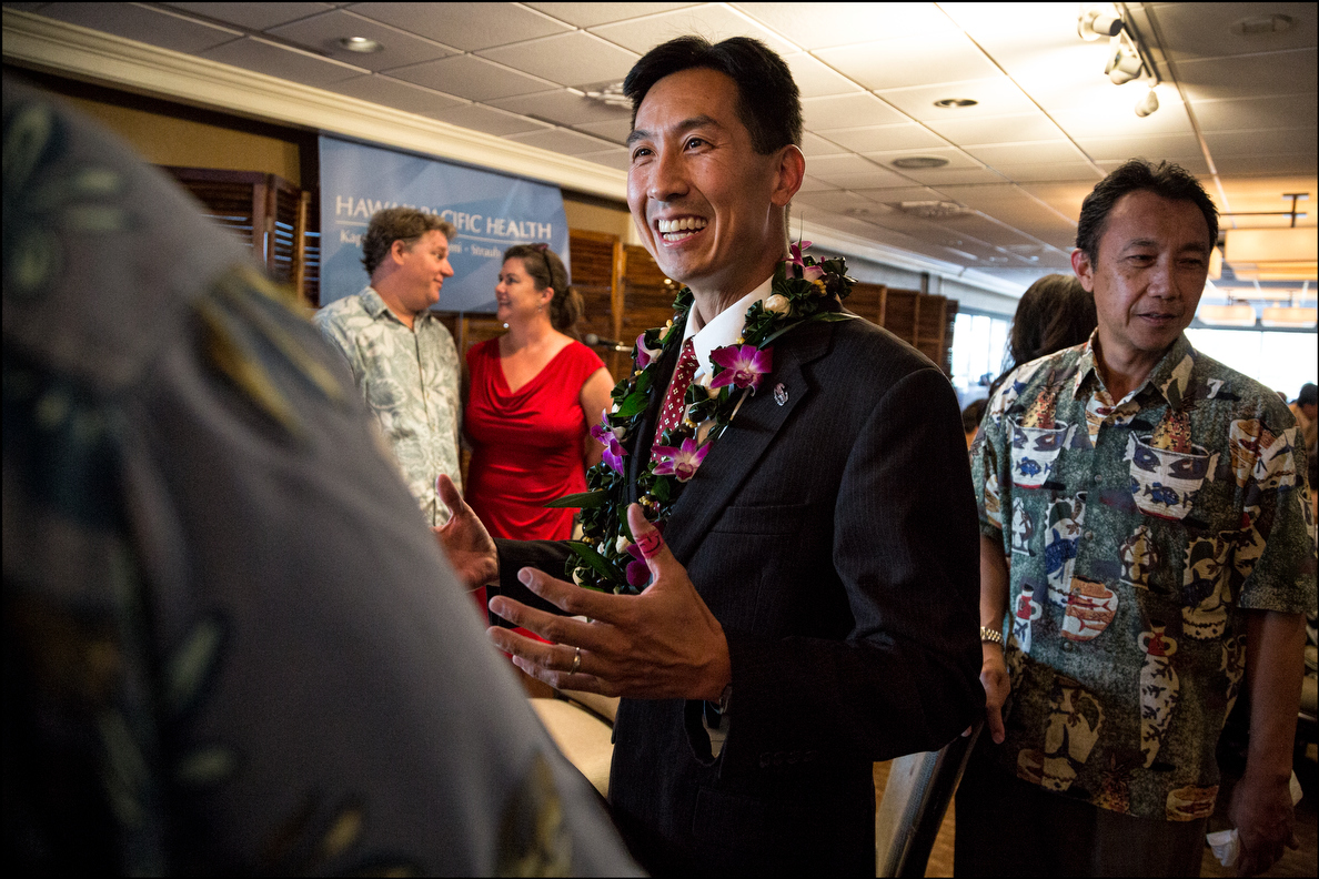 GOP Congressional District 1 candidate Charles Djou talks to audience members before a Chamber of Commerce debate Tuesday at the Plaza Club.