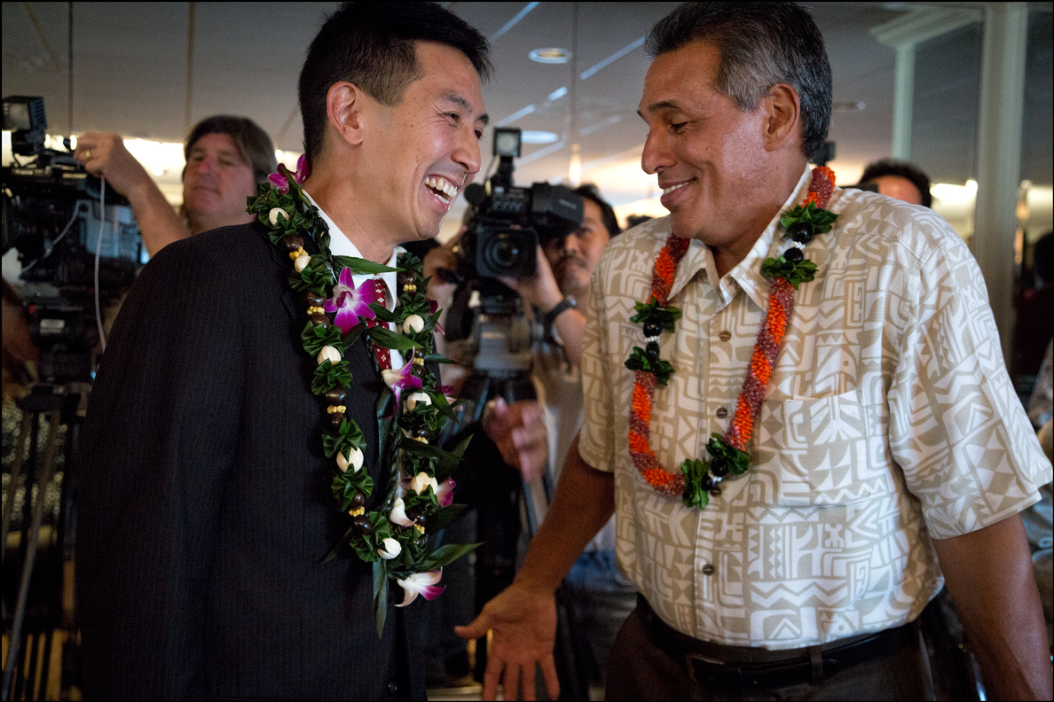 Gubernatorial contender Duke Aiona, right, shares a light moment with Djou before the Chamber debate.