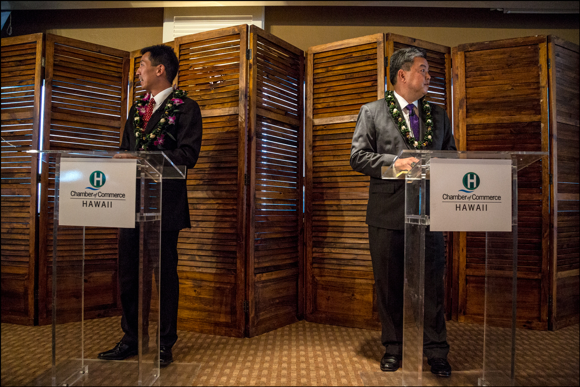Charles Djou on left and Mark Takai during Chamber of Commerce debate at the Plaza Club on September 23, 2014