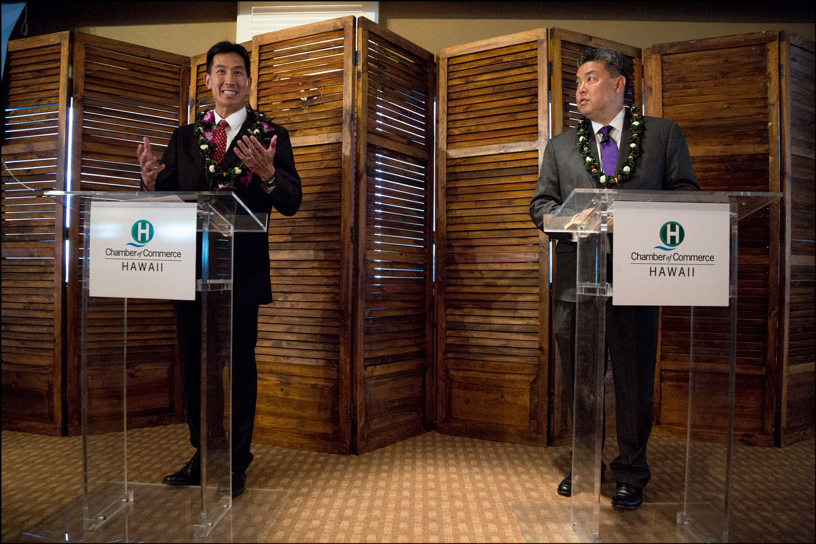 Republican Charles Djou, left, and Democrat Mark Takai have similar styles but very different views on issues.