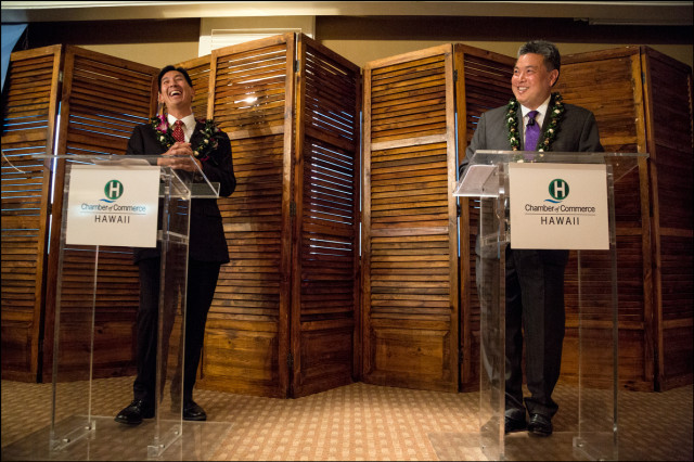 Charles Djou and Mark Takai share a laugh during congressional debate at the Plaza Club in Honolulu on September 23, 2014