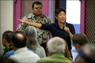 Opposed to the city of Honolulu's idea, Community activist Kathryn Xian speaks during a public meeting on the proposed Sand Island Housing First Transition Center held in the Pu'uhale Elementary School cafeteria on September 10, 2014
