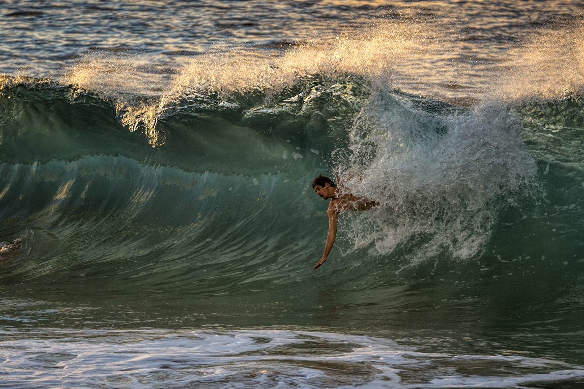 A bodysurfer makes the drop on a morning wave. He was one of many who hit the water.
