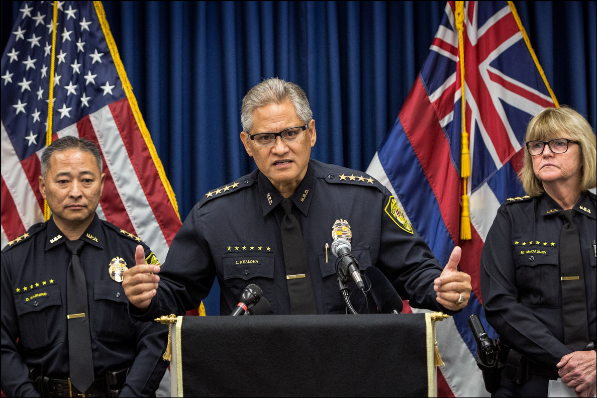 HPD Police Chief Louis Kealoha speaks during news conference concerning domestic violence on September 18, 2014. On left is Deputy Chief Dave Kajihiro and on right is Deputy Chief Marie McCauley.