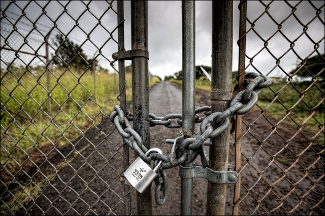 Chain at security fence at Red Hill Underground Fuel Facility. 1.29.14 ©PF Bentley/Civil Beat