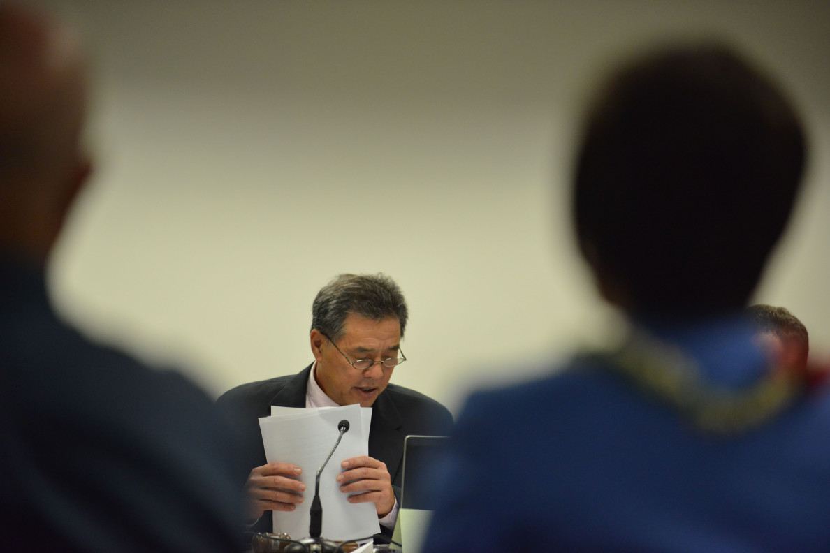 Special Investigative Committee on the Hawaii State Hospital Co-Chair Senator Clayton Hee reads findings in a report during hearings on October 22, 2014. 12pm.  photograph by Cory Lum.