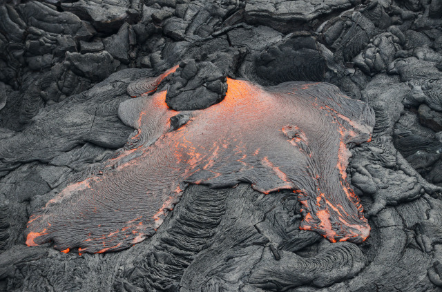 Molten lava breakout near today's flow towards Pahoa. 29 October 2014. photo Cory Lum.