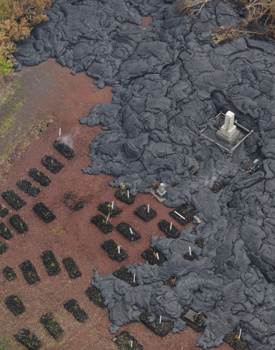 Lava stopped before covering gravestone markers near Pahoa, north boundary of Pahoa. 29 October 2014. photo Cory Lum.