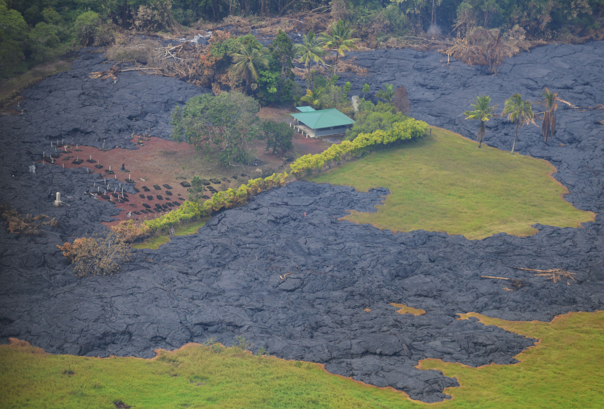 Earlier lava flow with that surrounded a home north of the live flow. 29 October 2014. photo Cory Lum.