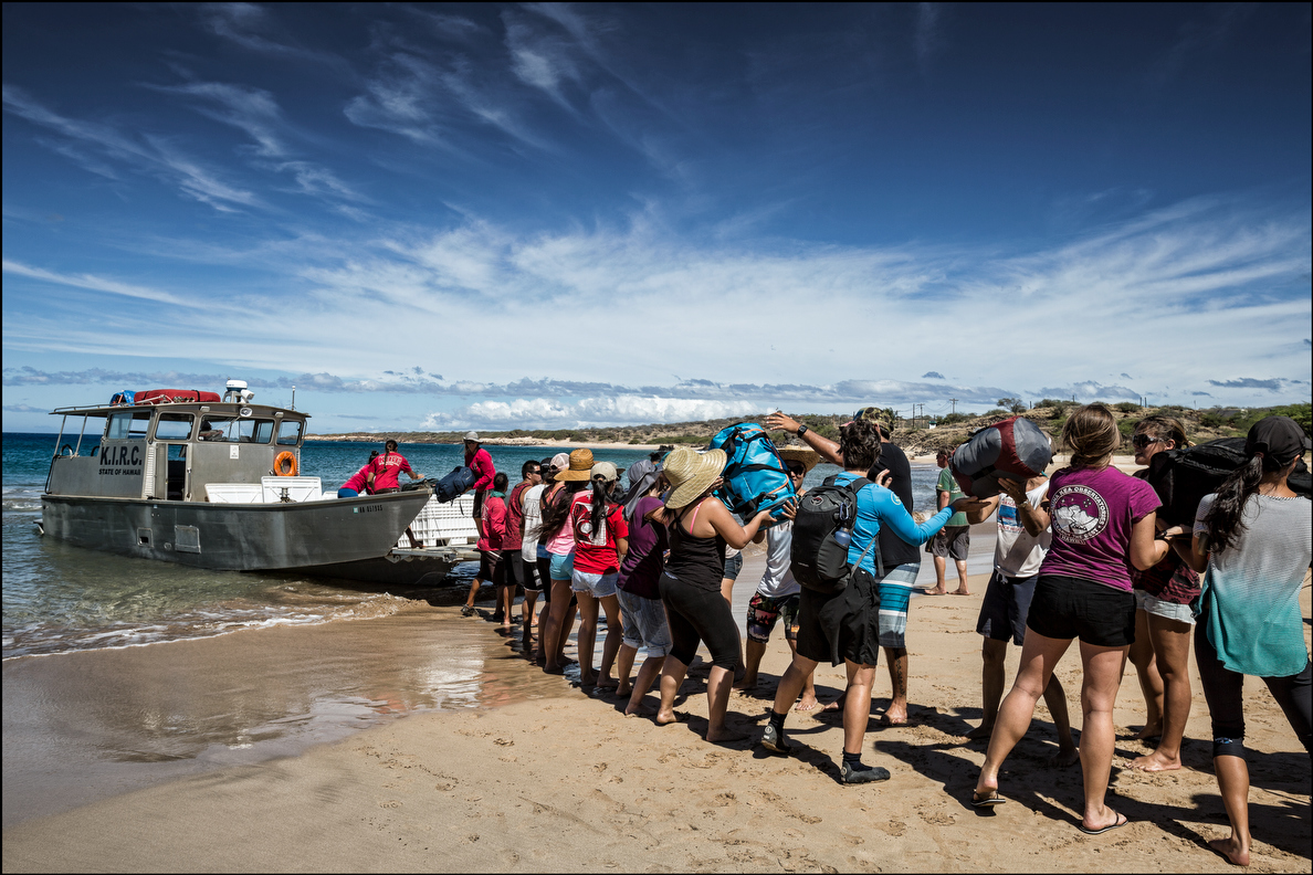 Students & faculty from the UH William S. Richardson School of Law bring bags ashore from the KIRC vessel after landing on Kahoolawe beach at Honokanai'a. 9.26.14