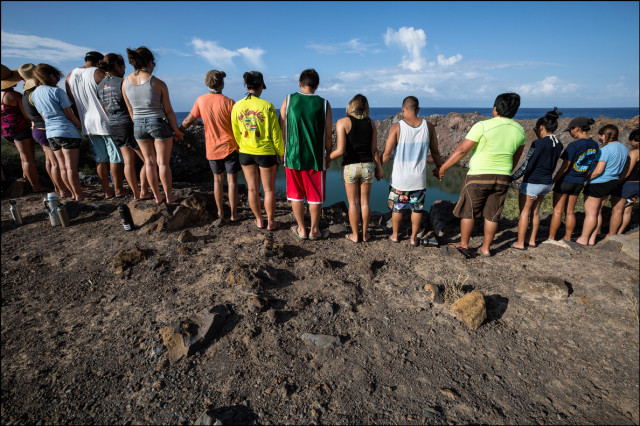 Students from the UH Richardson School of Law say a prayer for Kahoolawe's past and future at Sailor's Hat. 9.30.14