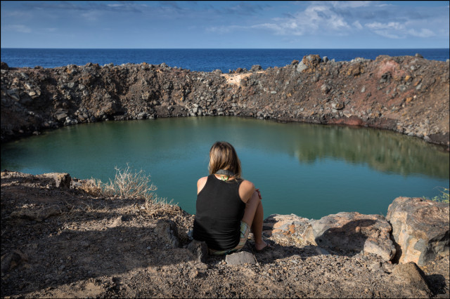 Civil Beat reporter Anita Hofschneider takes a moment to reflect at Sailor's Hat, Kahoolawe. 9.30.14