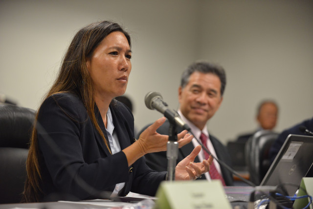Senator Maile S.L. Shimabukuro speaks at the Special Investigative Committee on the Hawaii State Hospital as Co-Chair Senator Clayton Hee looks on during a meeting on October 22, 2014. 12pm. photograph by Cory Lum.