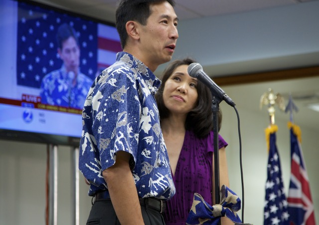 Republican Charles Djou delivers his concession speech as his wife Stacey listens in 2014 at his campaign headquarters in Kalihi.