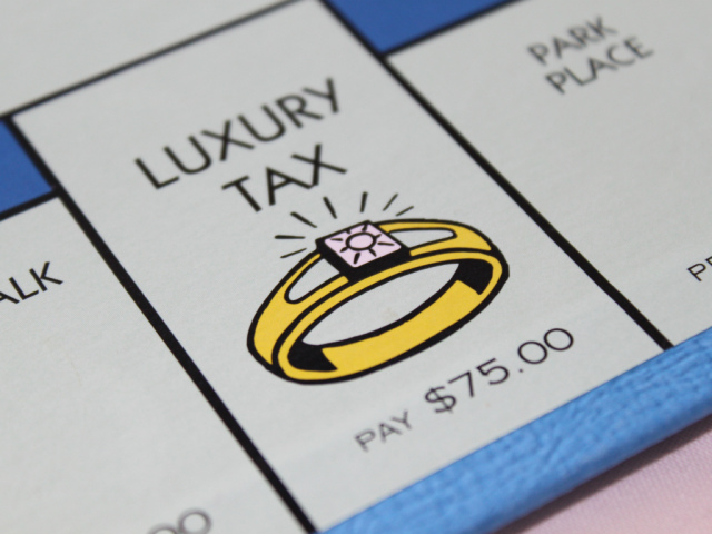 tax illustration monopoly board ring luxury tax