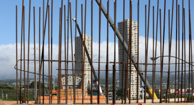Rebar frames the concrete pier foundations located near the H1 and H2 freeway merges fronting Leeward Community College. 25 nov 2014. photograph by Cory Lum.