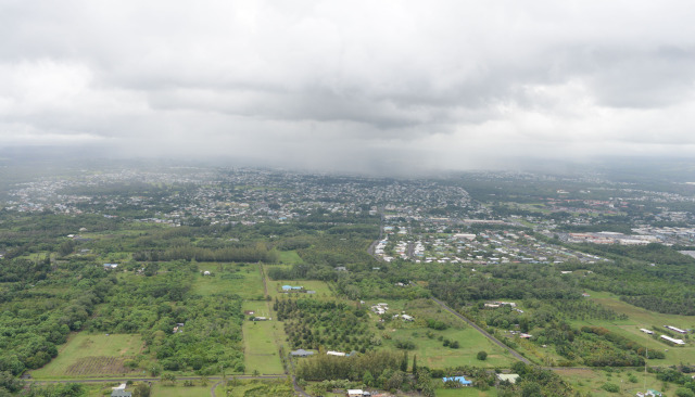 Aerial file view of Hilo town with Waiakea Uka slopes in middle frame of photograph. 29 october 2014. photograph Cory Lum