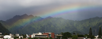 Light afternoon rains create a iridescent rainbow over Manoa Valley. 25 nov 2014. photograph Cory Lum.
