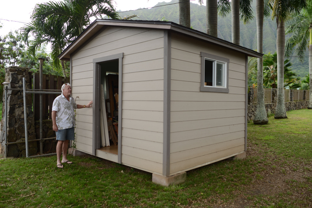 Kevin Andrews, President of Blue Star Steel Corp. stands fronting one his small homes that he makes. Waiamanalo, Hawaii. 28 nov 2014. photograph Cory Lum.