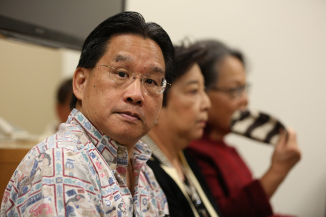 Attorney General of Hawaii David Louie sits with his team at the Hawaii State Ethics Commission conference room.  19 nov 2014. photo Cory Lum.