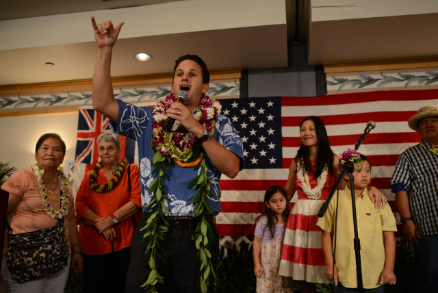 US Senator Brian Schatz speaks on stage at the Democratic Party of Hawaii's Democratic Coordinated Election Night Celebration held at the Japanese Cultural Center of Hawaii.  4 November 2014. photograph by Cory Lum