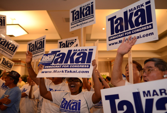 Mark Takai supporters cheer as the first count is announced at the Democratic Party of Hawaii's Democratic Coordinated Election Night Celebration held at the Japanese Cultural Center of Hawaii.  4 November 2014. photograph by Cory Lum
