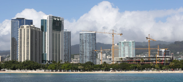 Buildings with backdrop of construction cranes near Kakaako and Ala Moana shopping center. 20 nov 2014. photo CORY LUM.