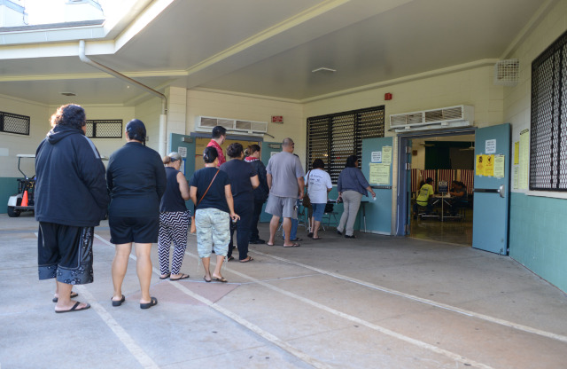People line up at the entrance to the cafeteria at Nanaikapono Elementary School located at 89-153 Mano Avenue in Waianae, Hawaii. 4 November 2014. photography by Cory Lum