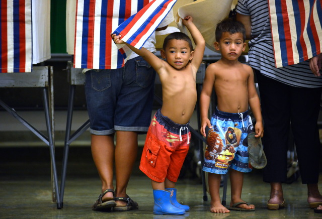3-year-old Lucan Keawe-Kekoa plays with Right, brother 5-year-old Aliiokekai Keawe-Kekoa while mom, Cassandra Kekoa casts her vote at Nanaikapono Elementary School located at 89-153 Mano Avenue in Waianae, Hawaii. 4 November 2014. photography by Cory Lum