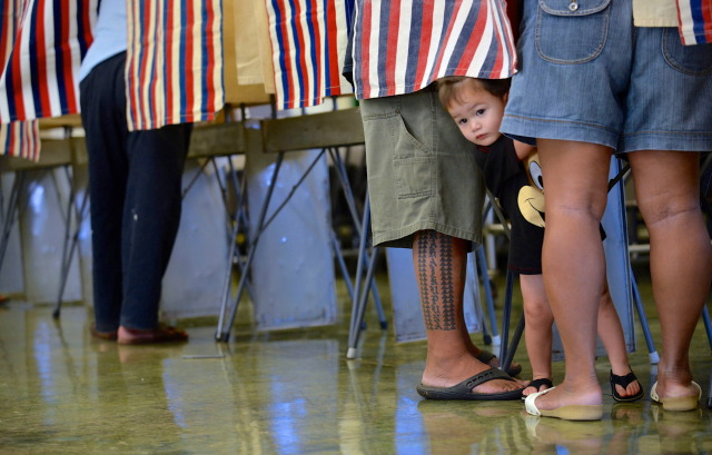 People cast their votes at Nanaikapono Elementary School located at 89-153 Mano Avenue in Waianae, Hawaii. 4 November 2014. photography by Cory Lum