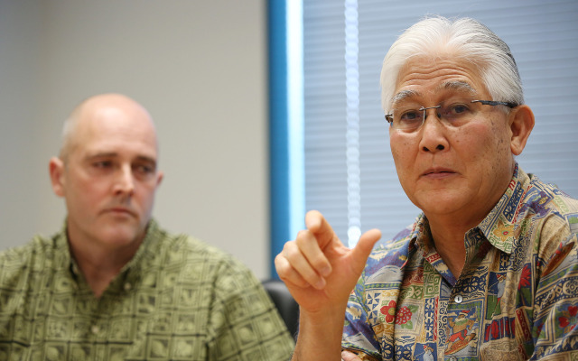 Right, President and Chief Executive Officer of Hawaiian Electric Alan Oshima and NEXTera President Eric Gleason speak to editorial board.  16 dec 2014. photograph Cory Lum