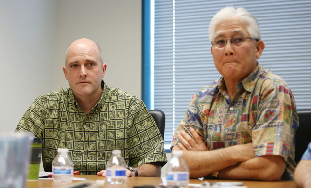 RIght,President and Chief Executive Officer of Hawaiian Electric Alan Oshima and NEXTera President Eric Gleason speak to editorial board. 16 dec 2014. photograph Cory Lum